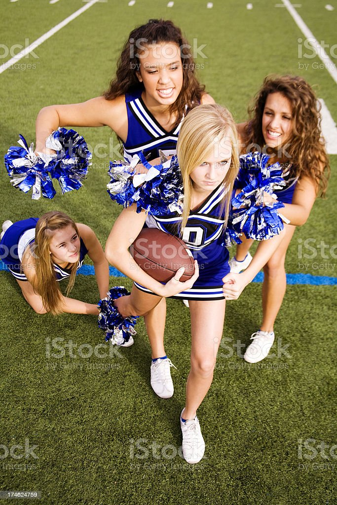 Tackle the Cheerleader stock photo