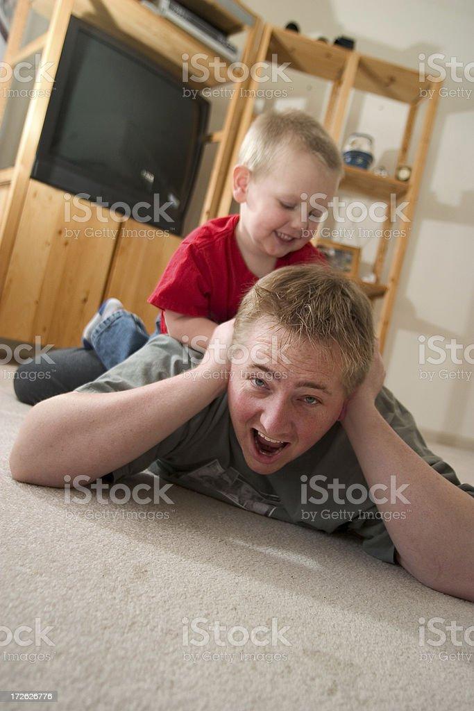 Tackled - Kids at play stock photo