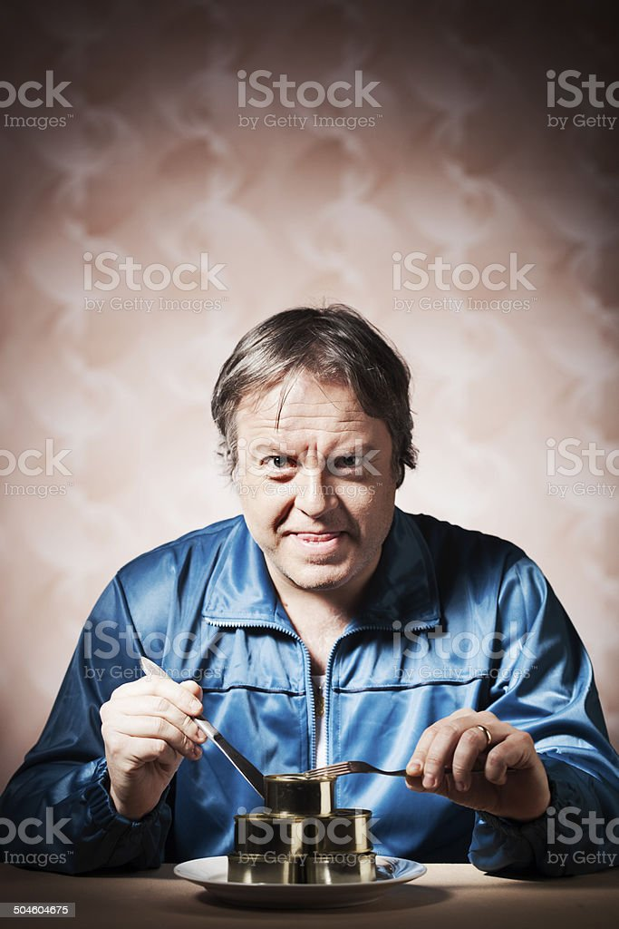 Tacky retro person in tracksuit wit humble meal. stock photo