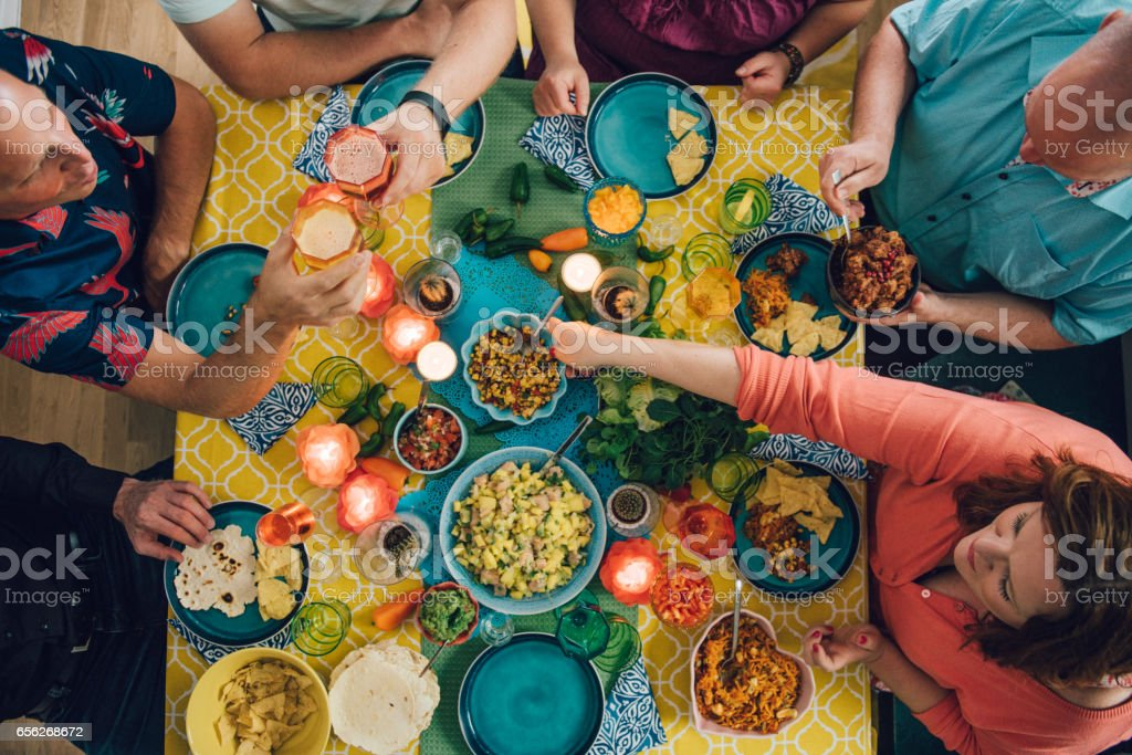 Taco Mexican tex med food lifestyles with friends eating dinner stock photo