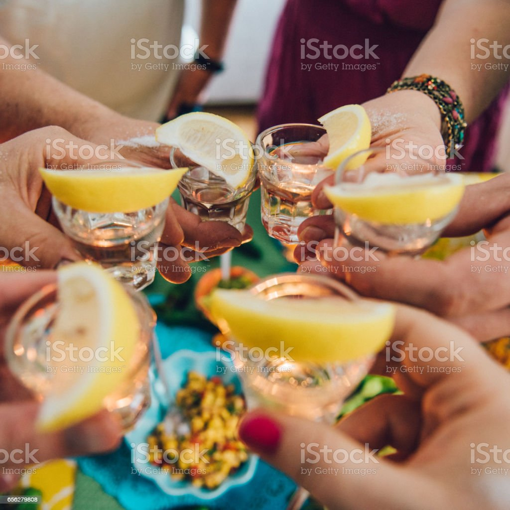 Taco Mexican tex med food lifestyles with friends having tequila stock photo