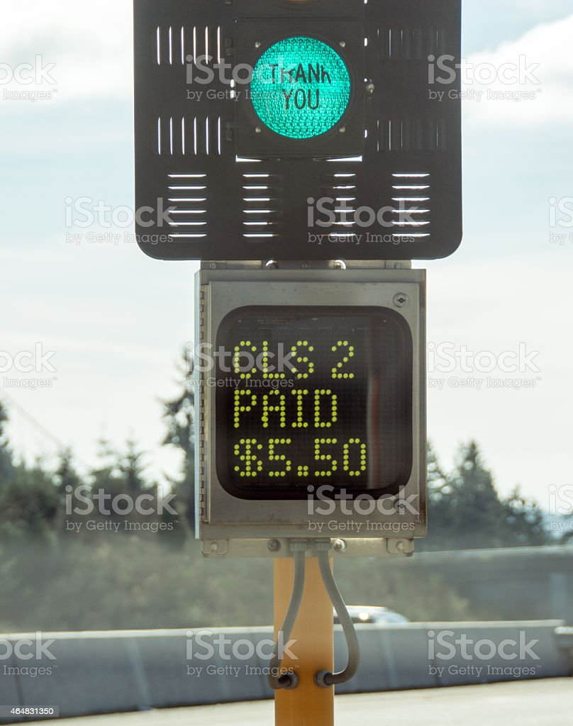 Tacoma Narrows Bridge toll booth sign... after paying. stock photo