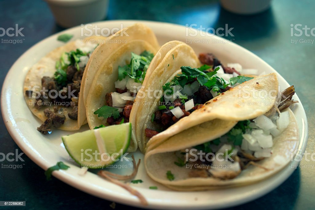 tacos al pastor and asada on a plate stock photo