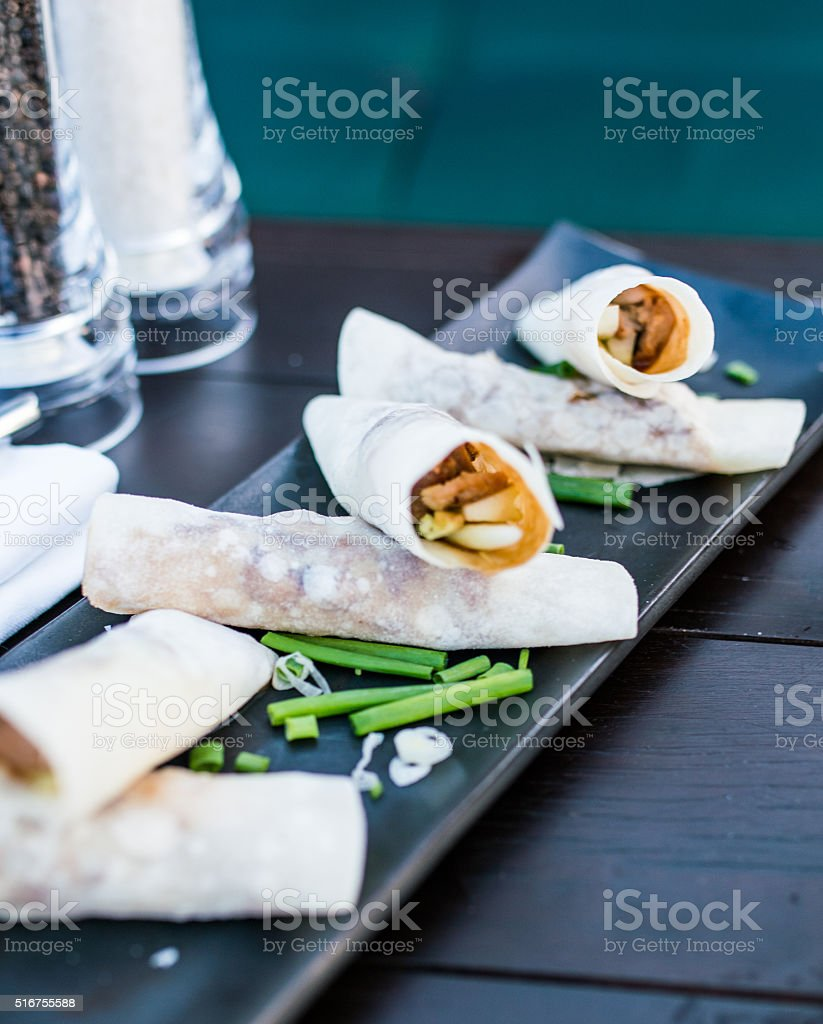 tacos in roll with meat stock photo