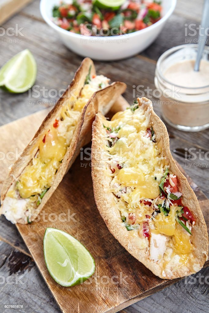 Tacos with chicken, cheddar cheese and pico de gallo stock photo