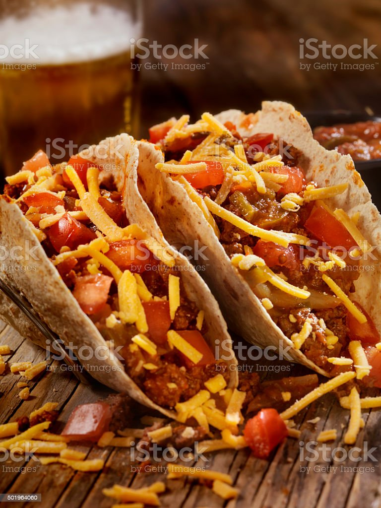 Tacos With Salsa, Cheese and a Beer stock photo