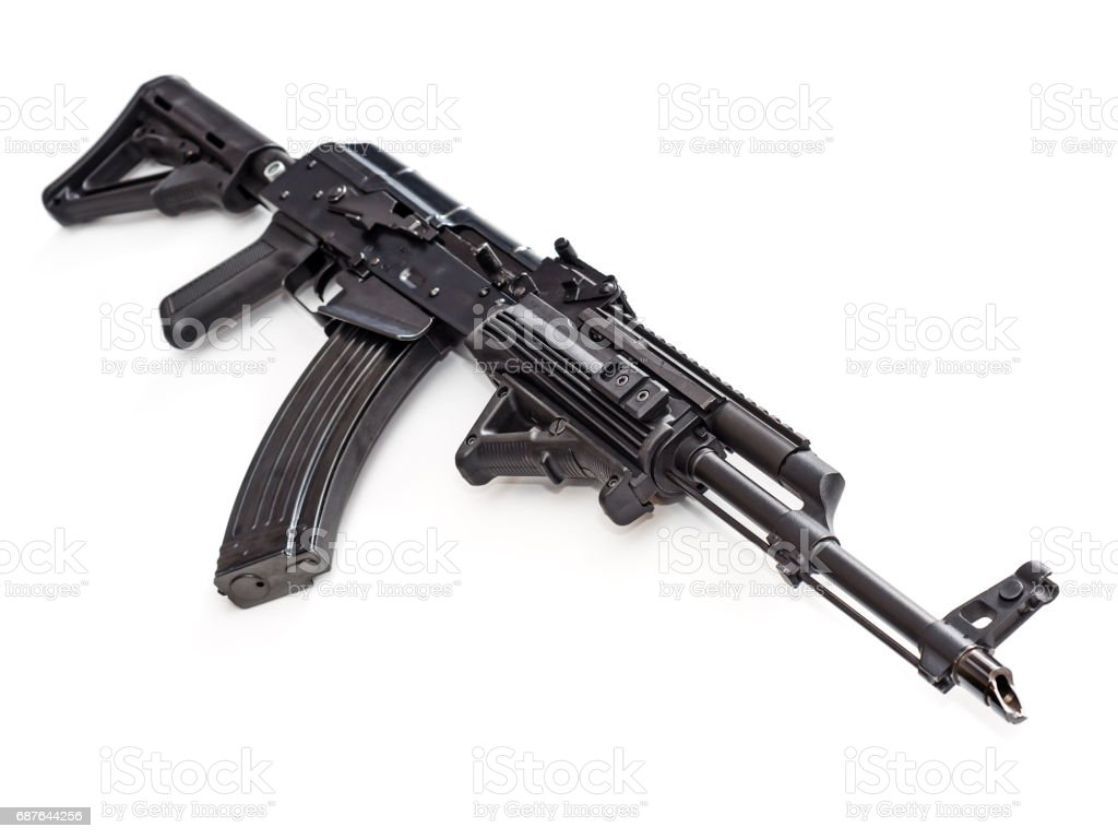 Tactical custom built AK-47 AKM rifle on white background, shallow depth of field stock photo