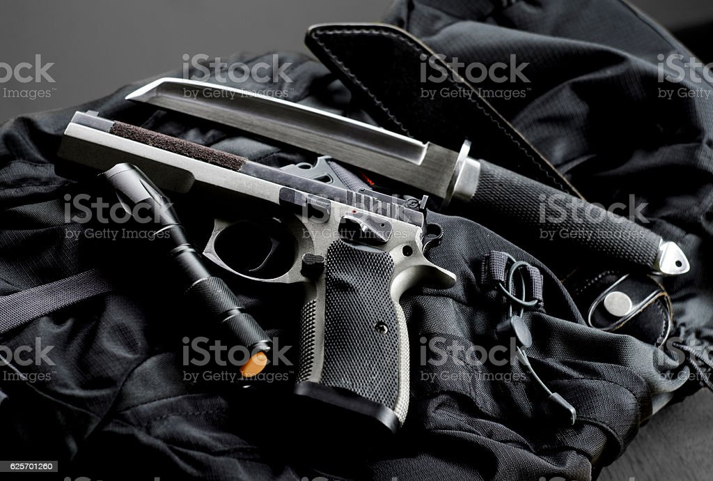 Tactical gun with a knife and flashlight stock photo