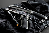 Tactical gun with a knife and flashlight