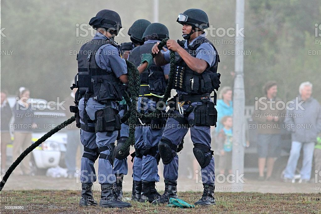 Tactical team gather their equipment after public display stock photo