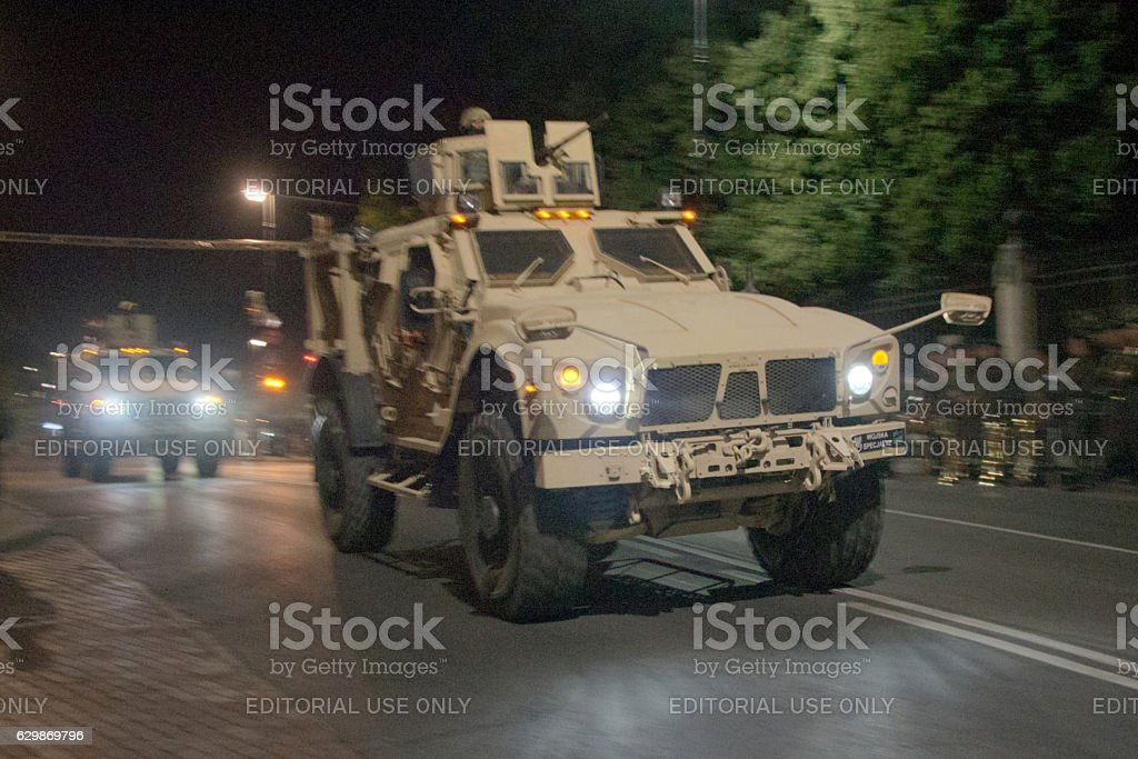 Tactical vehicle Oshkosh driving on the street at night stock photo