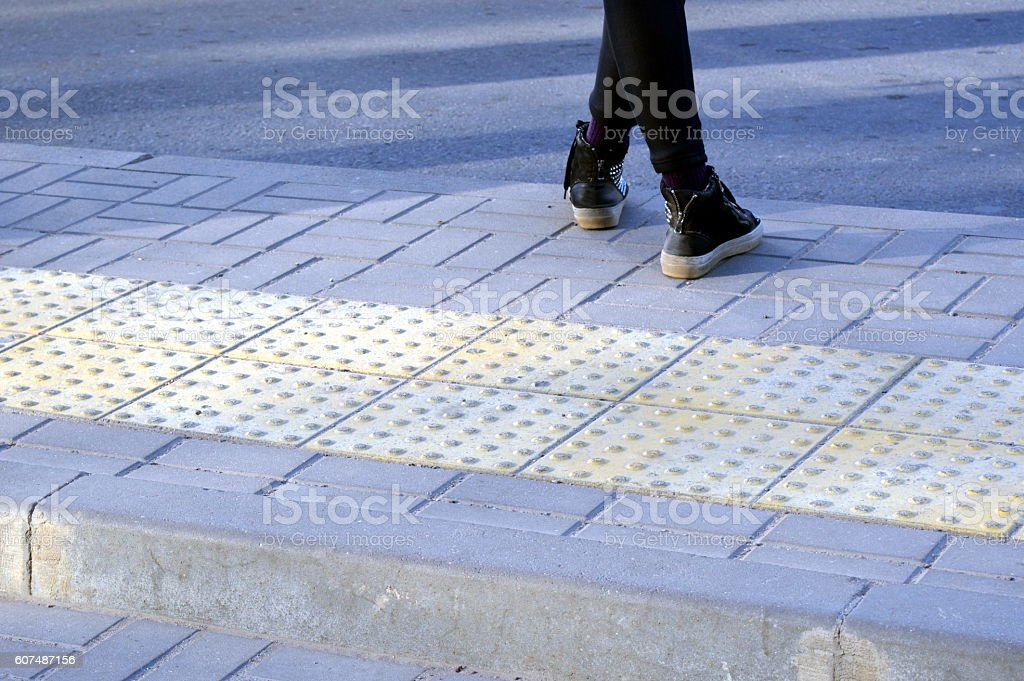 Tactile pavement - care for people with visual impairment stock photo