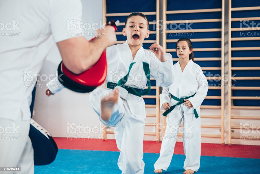 Tae kwon do instructor with kids on class stock photo