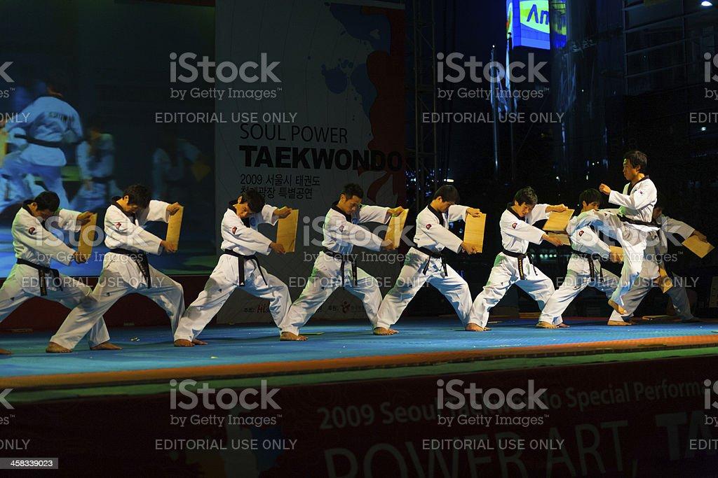 Taekwondo Kicking Breaking Row Wooden Boards stock photo