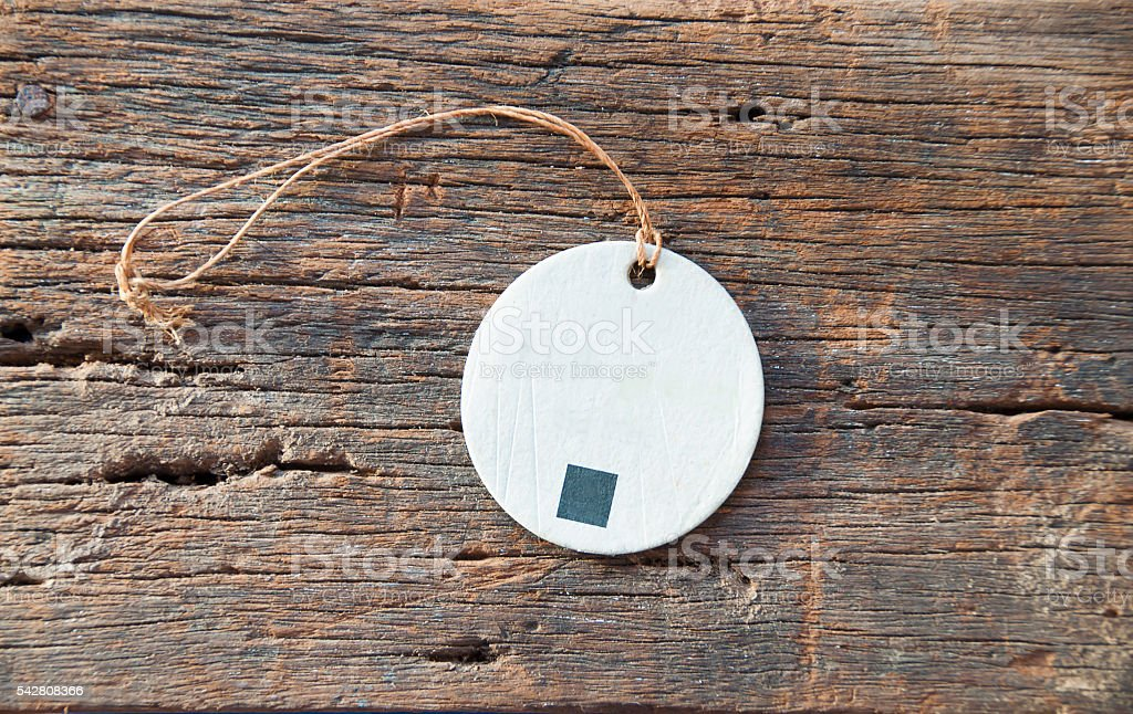 Tag label on old wooden texture stock photo