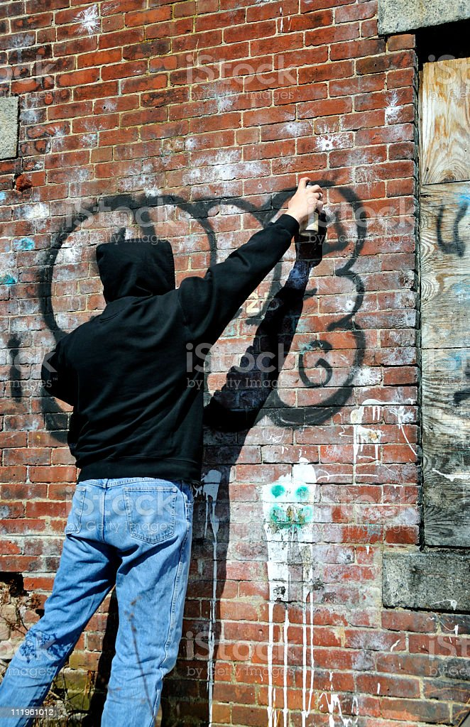 Tagger Makes Graffiti stock photo