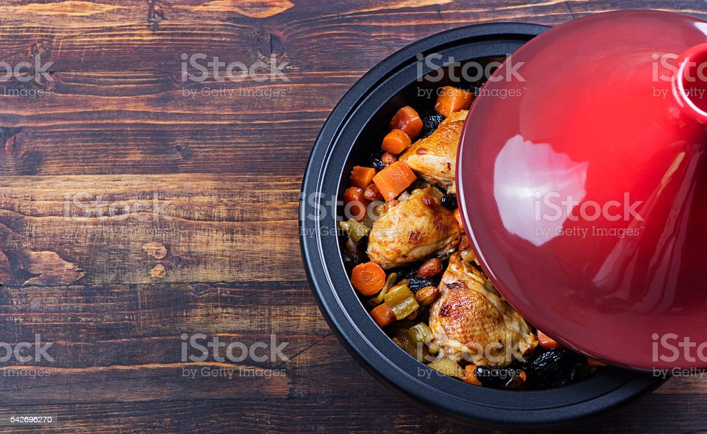 Tagine with cooked chicken and vegetables.Traditional moroccan cuisine stock photo