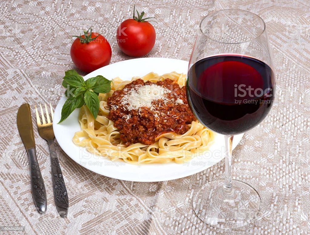 Tagliatelle al ragu Bolognese and wine Chianti stock photo