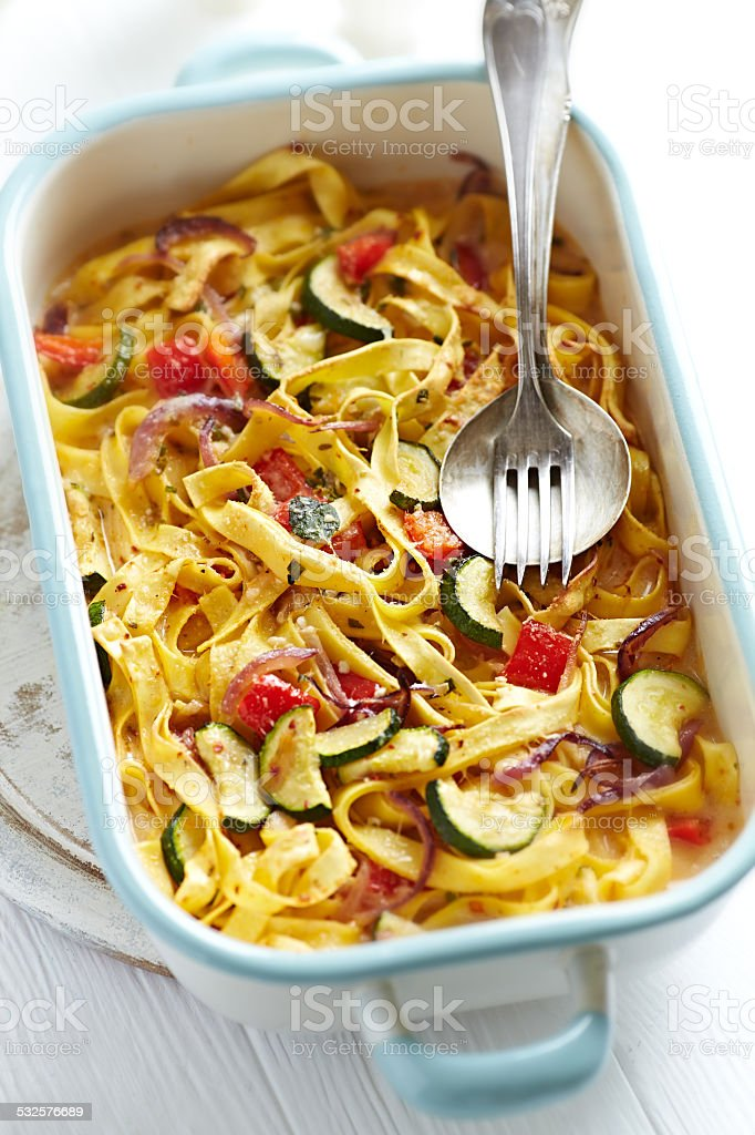 Tagliatelle baked with vegetables and parmesan stock photo