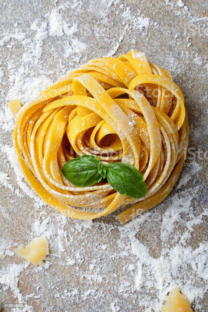 Tagliatelle italian pasta and basil closeup stock photo