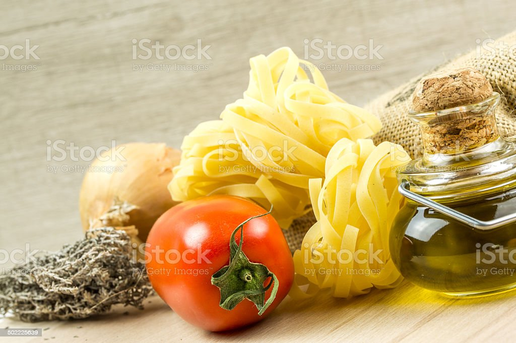 Tagliatelle pasta and tomatoes with herbs royalty-free stock photo