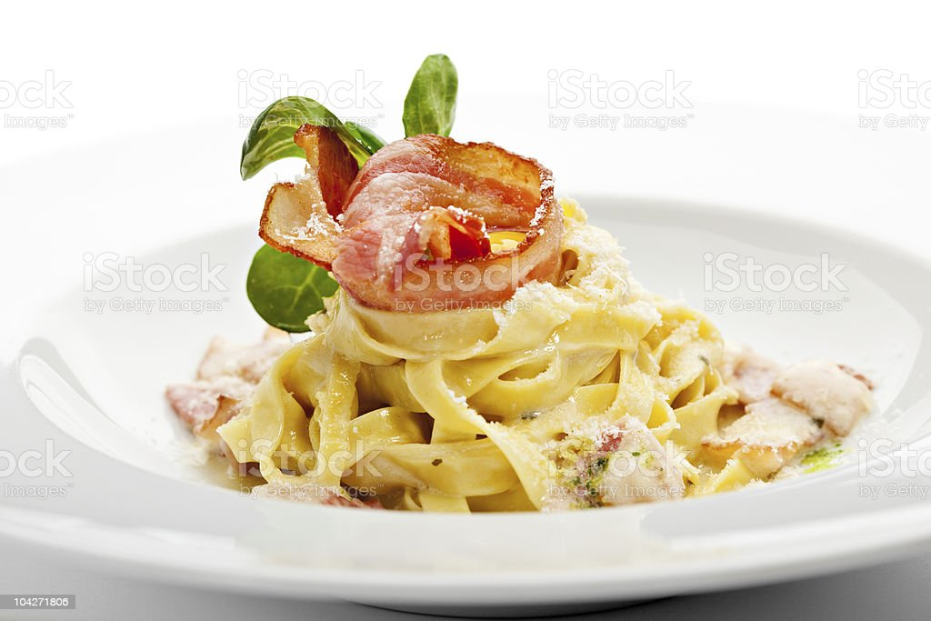 Tagliatelle pasta with bacon in a cream sauce royalty-free stock photo