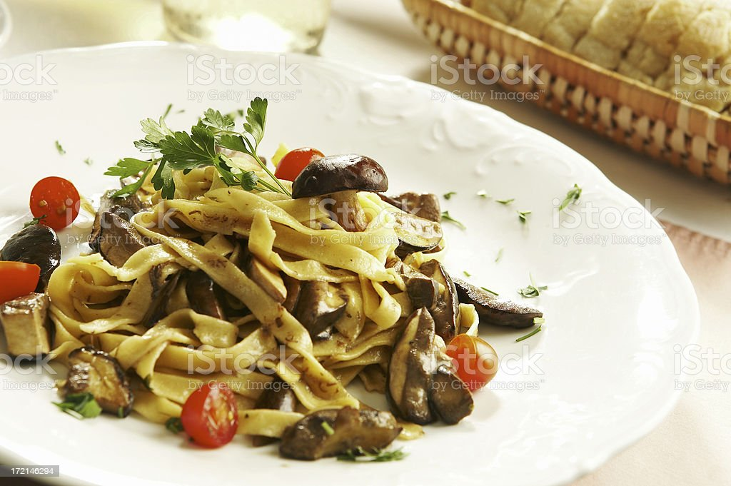 Tagliatelle pasta with mushrooms royalty-free stock photo