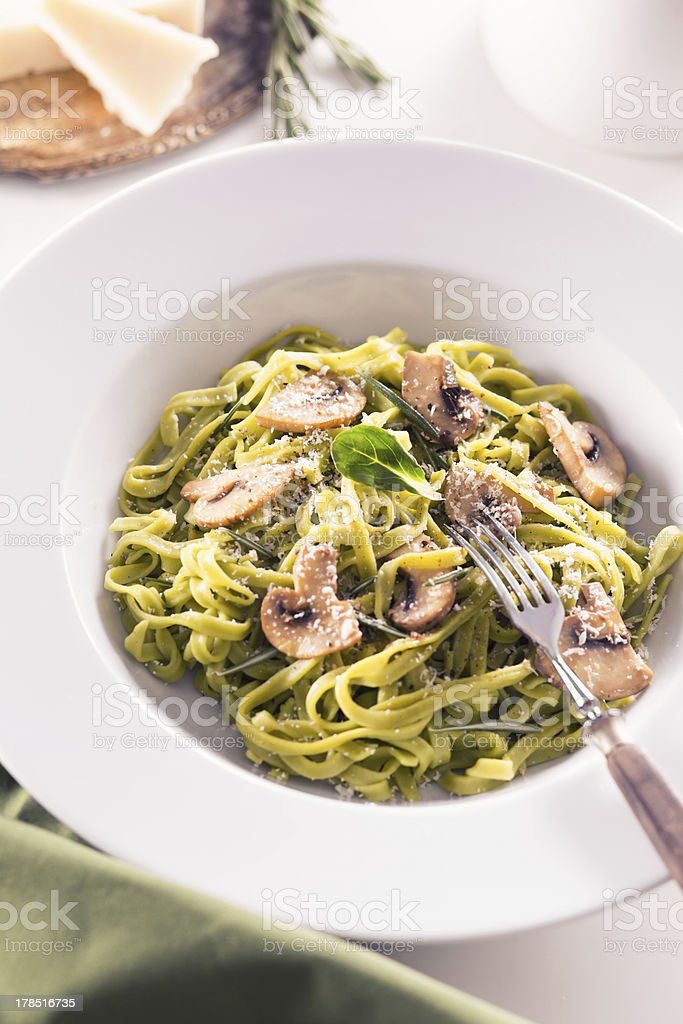 Tagliatelle pasta with pesto on white plate royalty-free stock photo