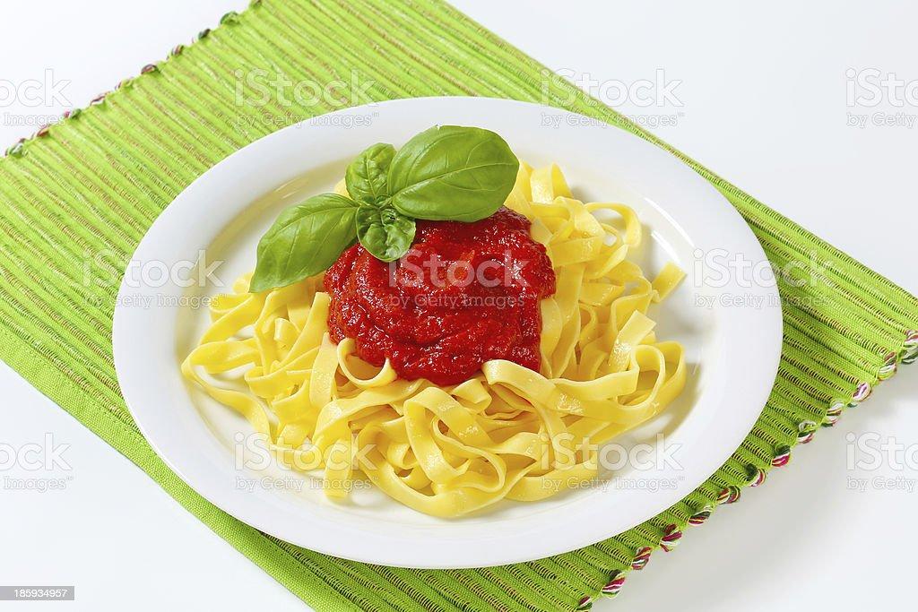 Tagliatelle pasta with tomato paste royalty-free stock photo