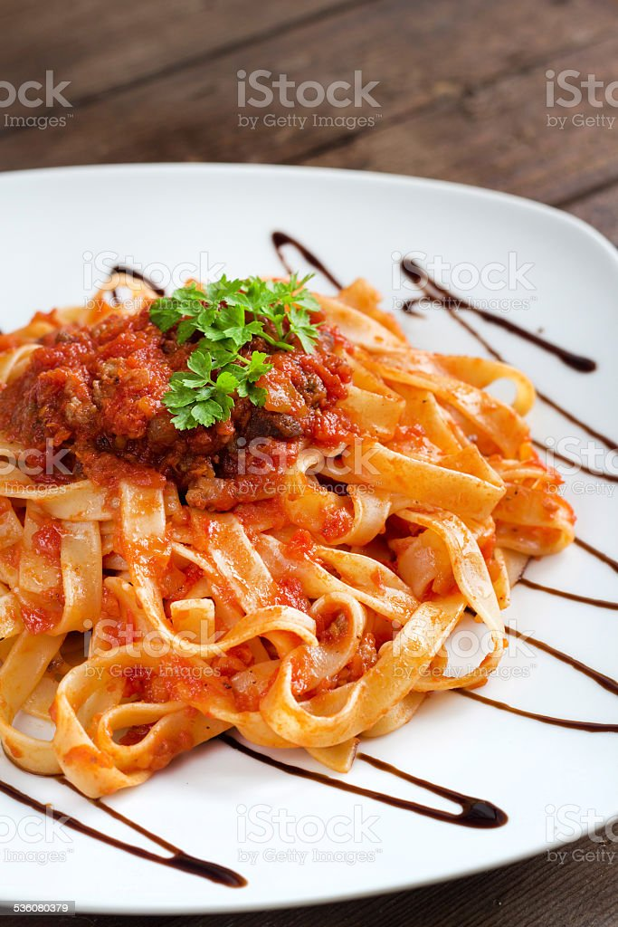 Tagliatelle with bolognese sauce stock photo