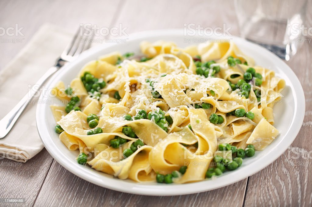 Tagliatelle with cream and peas stock photo