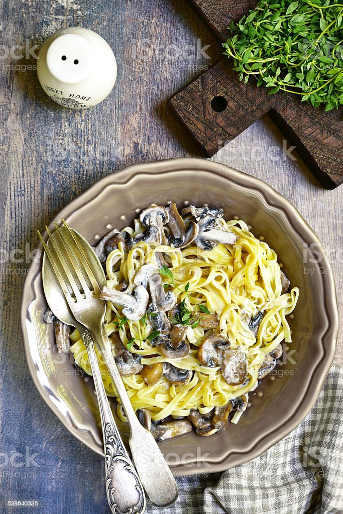 Tagliatelle with mushrooms and thyme. stock photo