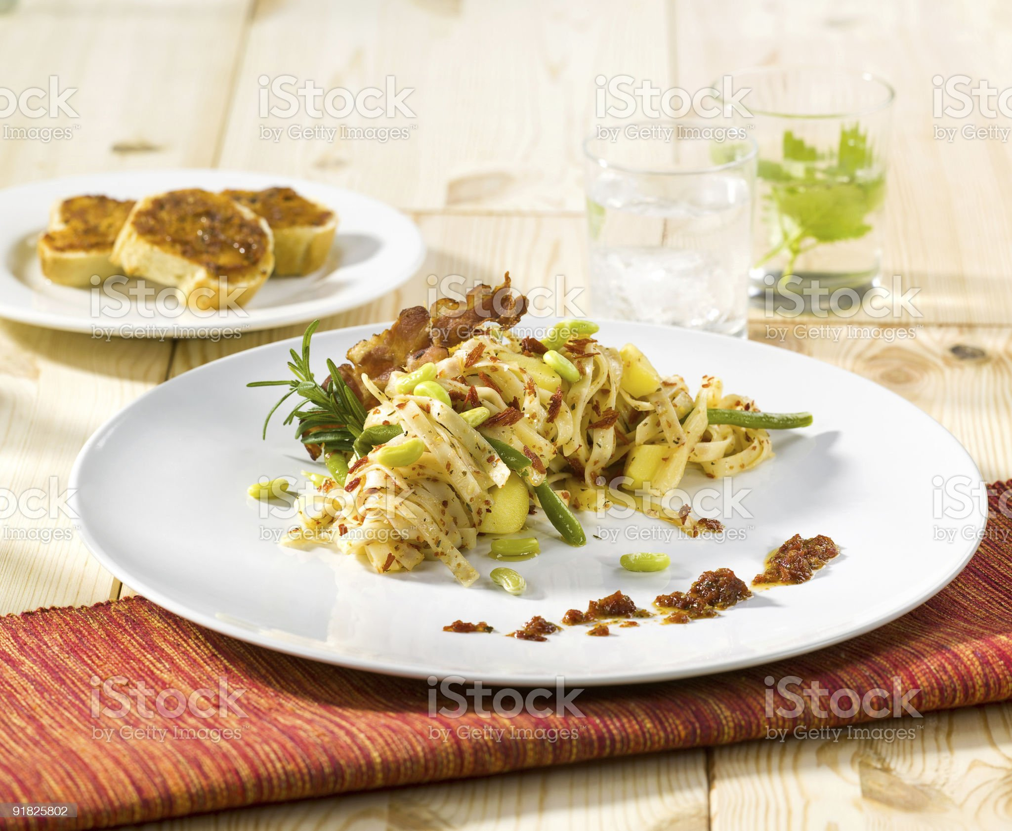 Tagliatelle with potatoes, beans and bacon royalty-free stock photo