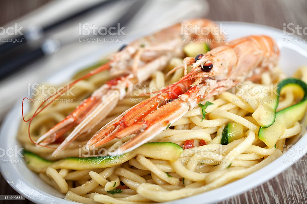 Tagliatelle with prawns and zucchini royalty-free stock photo