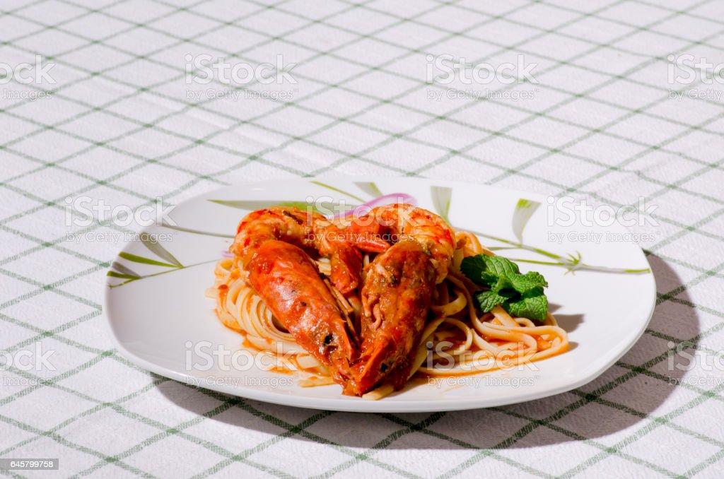 Tagliatelle with shrimps. stock photo