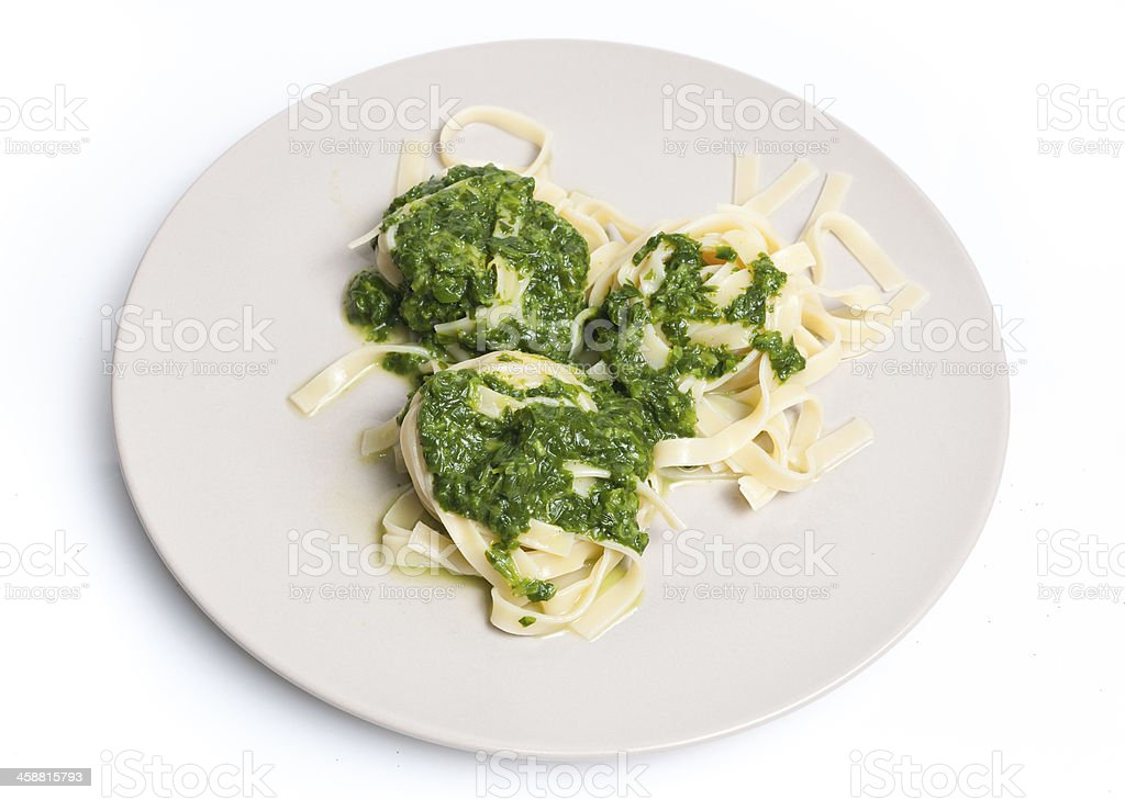 Tagliatelle with spinach on plate royalty-free stock photo
