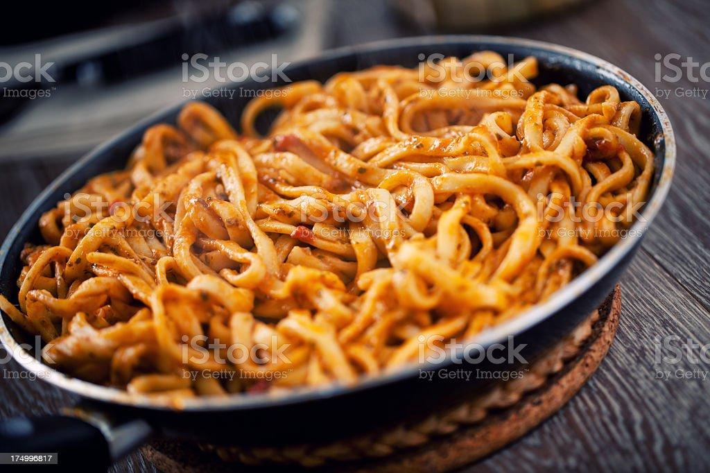 Tagliatelle with tomato sauce and pesto royalty-free stock photo