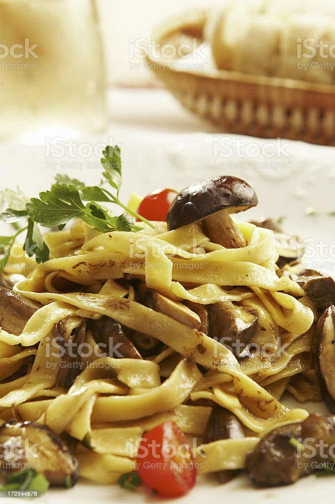 Tagliatelle with wild mushrooms royalty-free stock photo