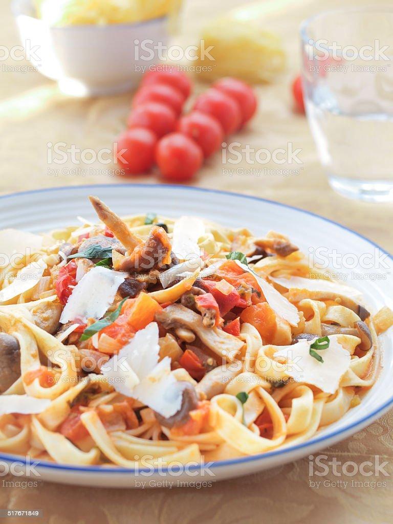 Tagliatelle with wild mushrooms stock photo