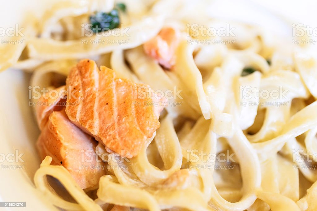 tagliatelle with with salmon and basil stock photo