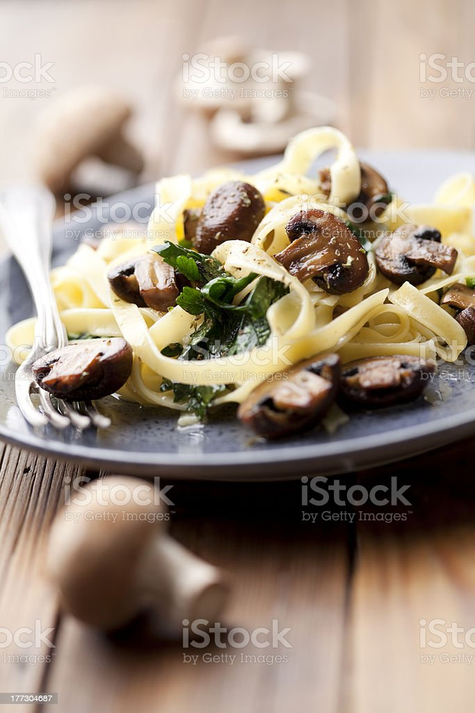 tagliatelles with spinach and mushrooms stock photo