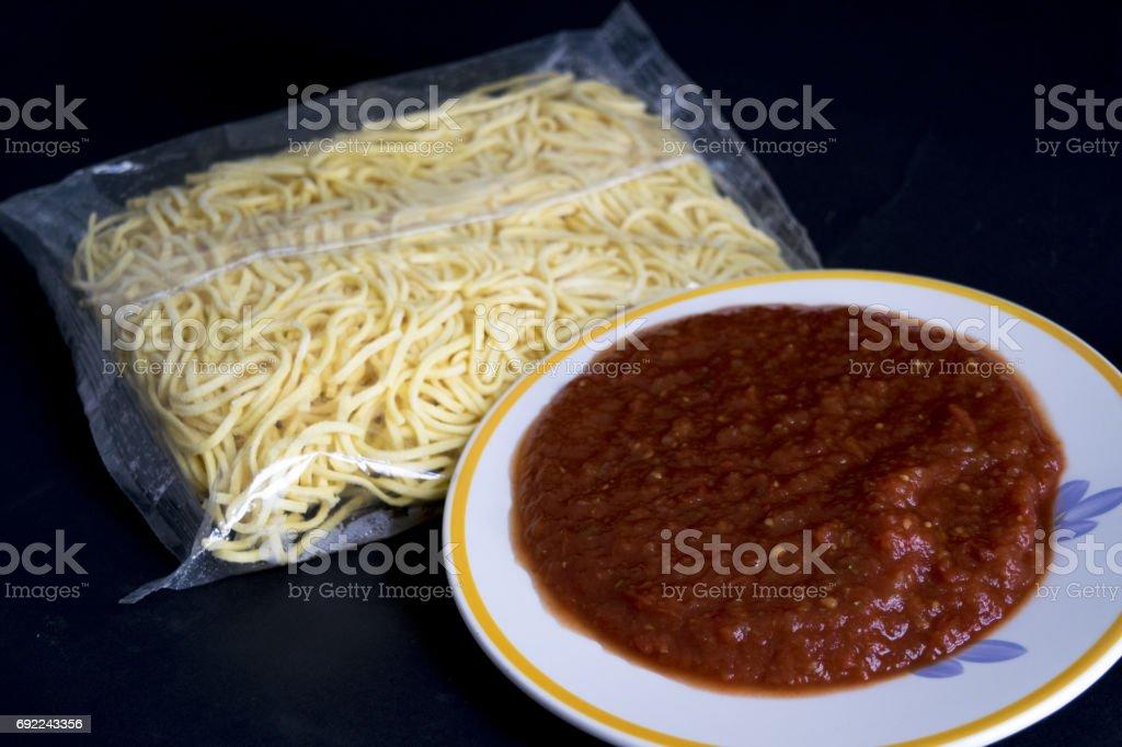 tagliolini and tomato puree stock photo