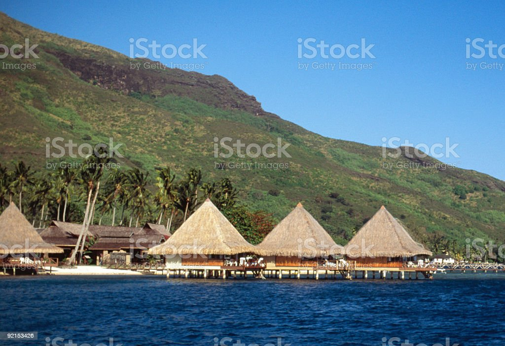 Tahiti style tropical beach bungalows royalty-free stock photo