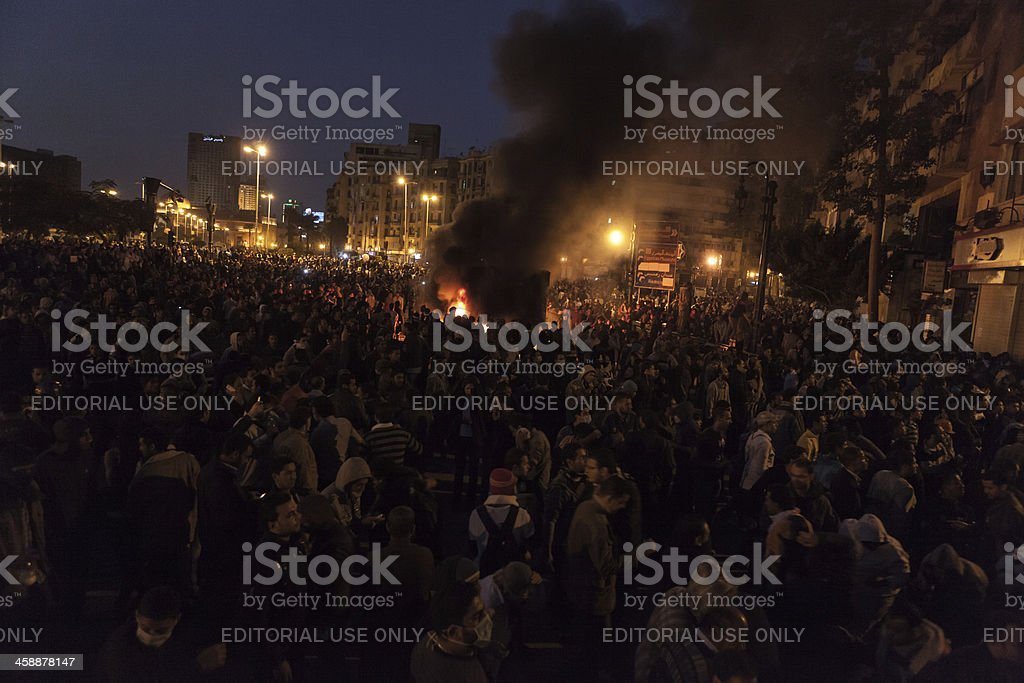 Tahrir Square demonstration with a burning police truck stock photo