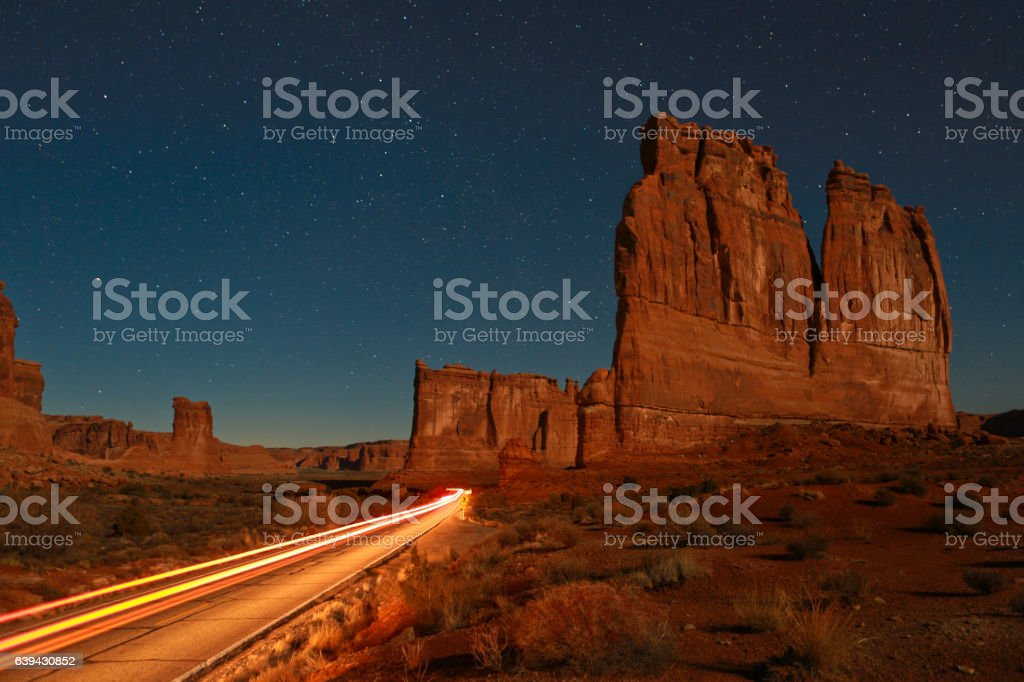 Tail Lights glow in Arches National Park Night stock photo
