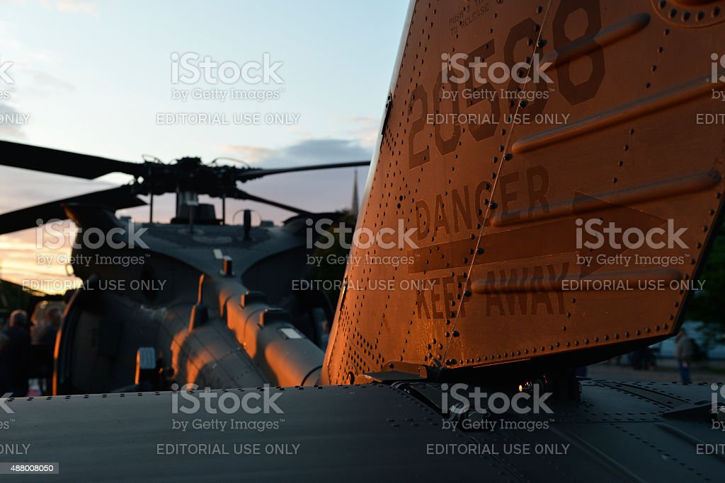 Tail of an American Blackhawk helicopter at sunset stock photo