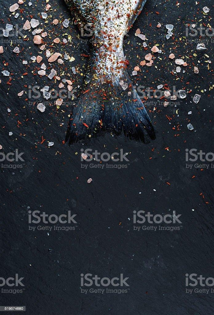 Tail of fresh raw Dorado or sea bream fish on stock photo