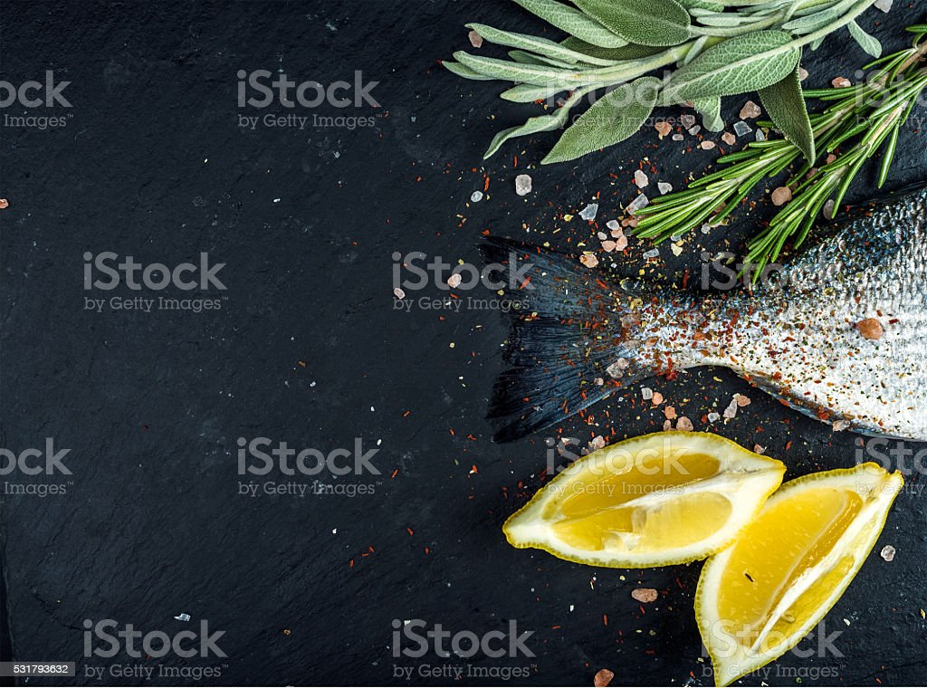 Tail of fresh raw Dorado or sea bream fish on stock photo