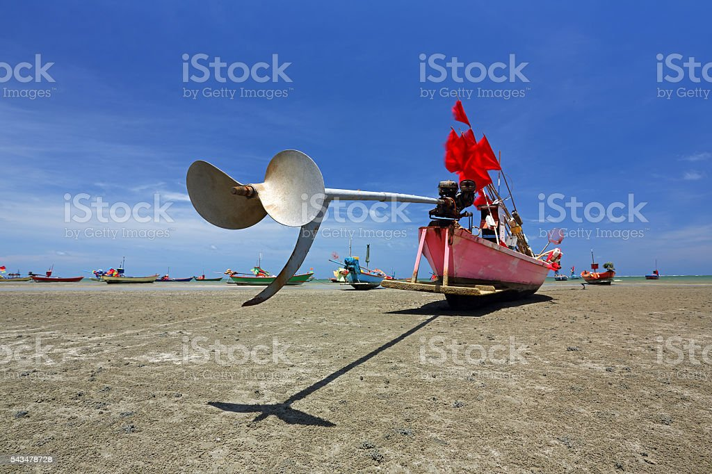 Tail rotor blade of fishing boats and red flags stock photo