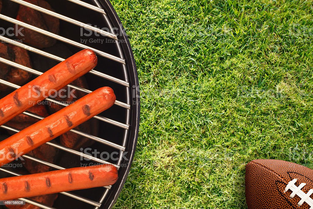 Tailgate BBQ with Hotdogs and American Football stock photo